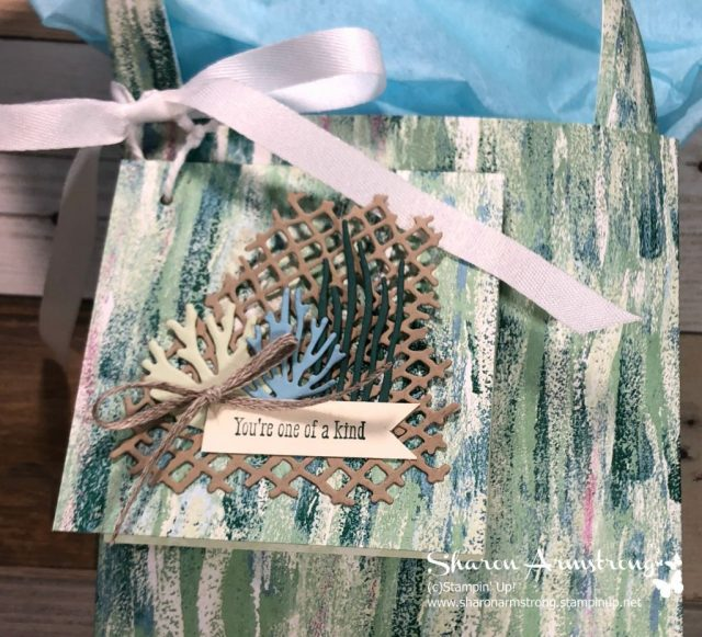 Watch this gift bag tutorial! Learn how to make a gift bag with this step-by-step video tutorial by Sharon Armstrong, TxStampin. Perfect for gift giving year round…Christmas, Birthdays, or other occasions. #christmascrafts #cardmaking #papercrafting #SharonArmstrong #txstampin